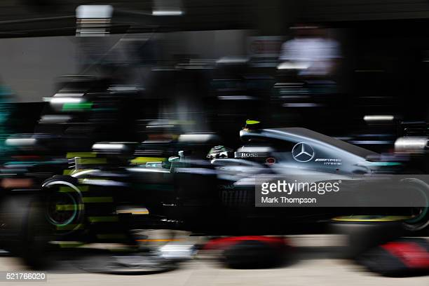 Nico Rosberg of Germany driving the Mercedes AMG Petronas F1 Team Mercedes F1 WO7 Mercedes PU106C Hybrid turbo comes into pitstop for new tyres...