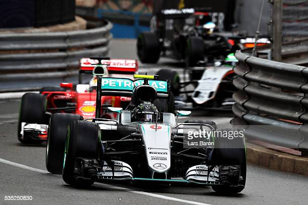 Nico Rosberg of Germany driving the Mercedes AMG Petronas F1 Team Mercedes F1 WO7 Mercedes PU106C Hybrid turbo leads Sebastian Vettel of Germany...