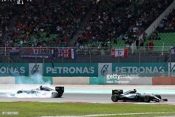 Nico Rosberg of Germany driving the Mercedes AMG Petronas F1 Team Mercedes F1 WO7 Mercedes PU106C Hybrid turbo spins behind Lewis Hamilton of Great...