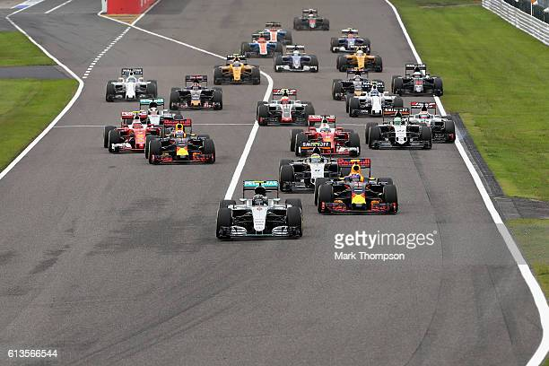 Nico Rosberg of Germany driving the Mercedes AMG Petronas F1 Team Mercedes F1 WO7 Mercedes PU106C Hybrid turbo leads Max Verstappen of the...