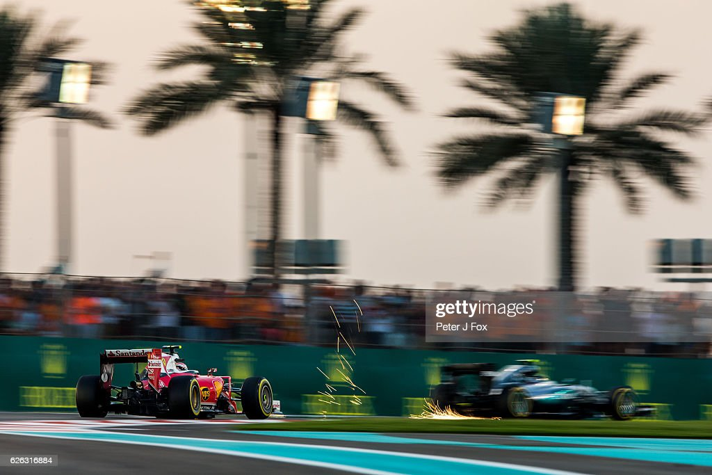 Nico Rosberg of Mercedes and Germany exits the pits just in front of Kimi Raikkonen of Ferrari and Finland during the Abu Dhabi Formula One Grand Prix at Yas Marina Circuit on November 27, 2016 in Abu Dhabi, United Arab Emirates.