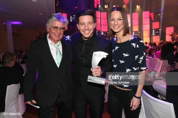 Nico Santos and his father Egon Wellenbrink and Christina Stuermer during the Audi Generation Award 2018 at Hotel Bayerischer Hof on December 11 2018...