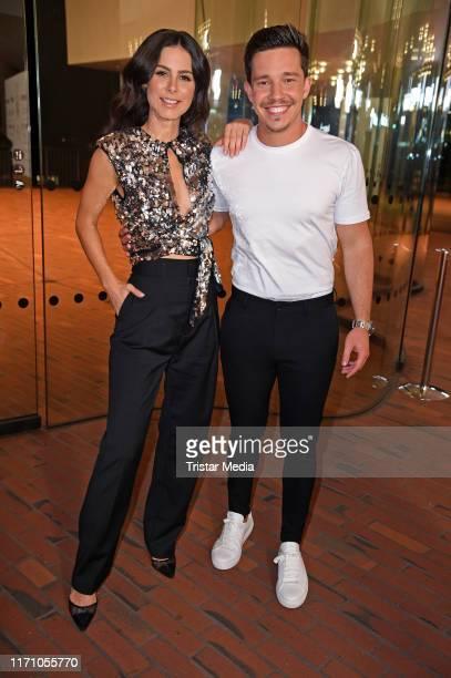 Nico Santos and Lena MeyerLandrut attend the Deutscher Radiopreis at Elbphilharmonie on September 25 2019 in Hamburg Germany