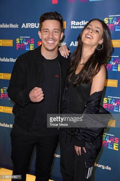 Nico Santos and Lena MeyerLandrut attend the 'Stars for free' music festival at Barclaycard Arena on August 17 2019 in Hamburg Germany