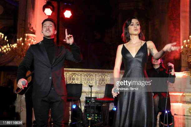 Nico Santos and Lena Meyer-Landrut perform on stage during the Tribute To Bambi after show party at Kurhaus Baden-Baden on November 20, 2019 in...