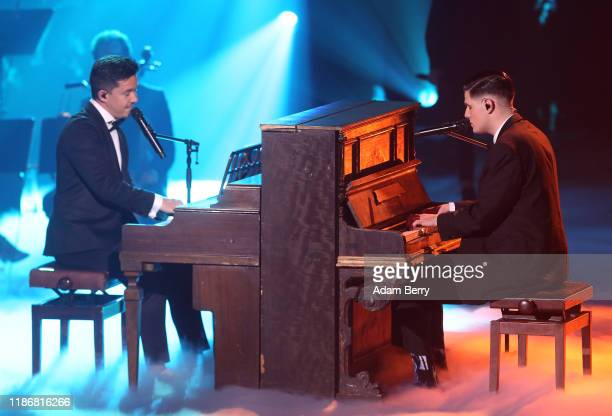 """Nico Santos and Lucas Rieger perform during the finals of """"The Voice of Germany"""" on November 10, 2019 in Berlin, Germany."""