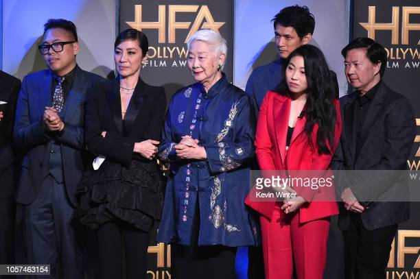 Nico Santos, Michelle Yeoh, Lisa Lu, Harry Shum Jr., Awkwafina, and Ken Jeong accept the Hollywood Breakout Ensemble Award onstage during the 22nd...