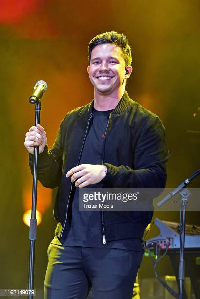 Nico Santos performs the 'Stars for free' music festival at Barclaycard Arena on August 17, 2019 in Hamburg, Germany.