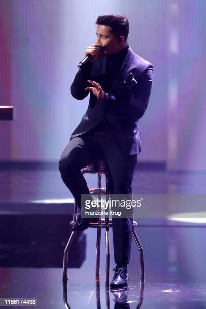 Nico Santos sings on stage during the GQ Men of the Year Award show at Komische Oper on November 07, 2019 in Berlin, Germany.