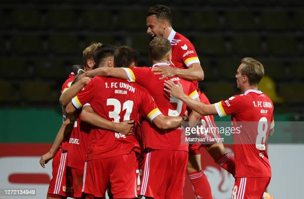 Nico Schlotterbeck of Berlin celebrates his team's first goal with teammates during the DFB Cup first round match between Karlsruher SC and 1. FC...