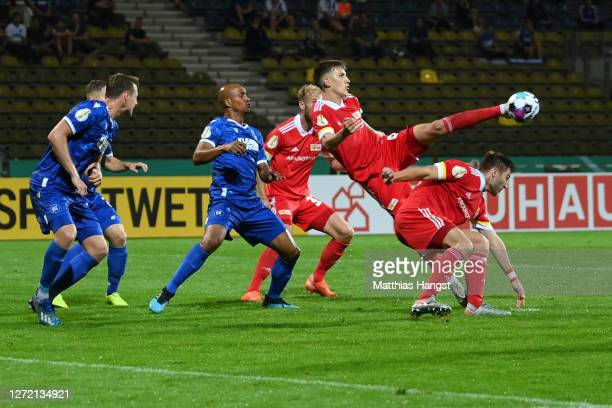Nico Schlotterbeck of Berlin scores his team's first goal during the DFB Cup first round match between Karlsruher SC and 1. FC Union Berlin at...