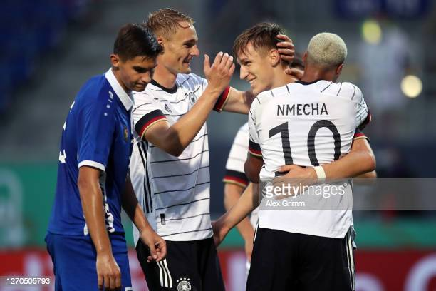 Nico Schlotterbeck of Germany celebrates his team's third goal with teammates during the UEFA Euro Under 21 Qualifier match between Germany U21 and...