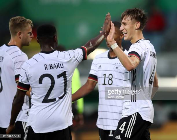 Nico Schlotterbeck of Germany U21 celebrates with teammate Ridle Baku of Germany U21 after scoring his team's third goal during the UEFA Euro Under...