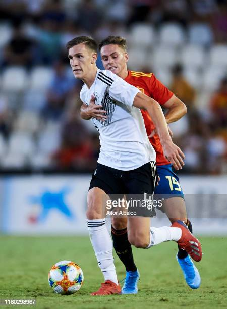 Nico Schlotterbeck of Germany U21 duels for the ball with Dani Gomez of Spain U21 during the international friendly between Spain U21 and Germany U21...
