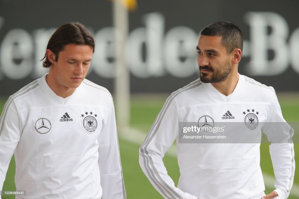 Nico Schulz (L) and Ilkay Guendogan arrive at the venue prior to a training session of the German national team at FC Bayern Campus on September 3, 2018 in Munich, Germany.