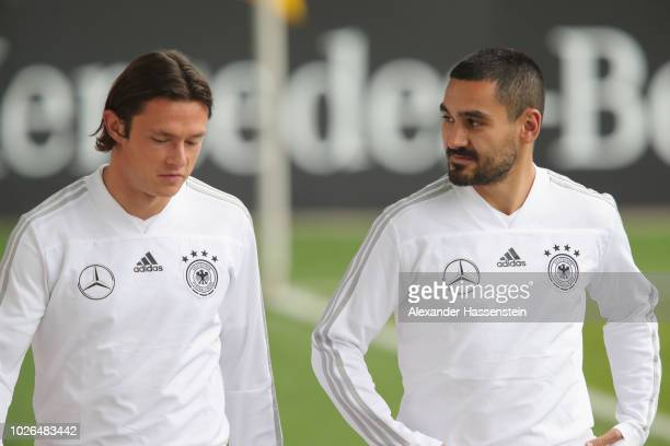 Nico Schulz and Ilkay Guendogan arrive at the venue prior to a training session of the German national team at FC Bayern Campus on September 3 2018...