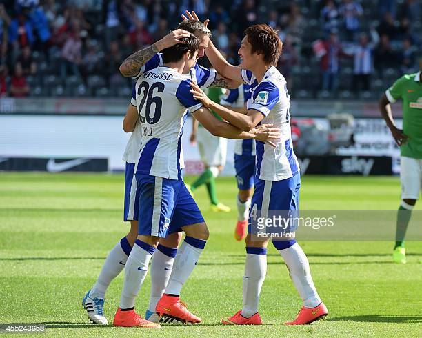 Nico Schulz Julian Schieber and Genki Haraguchi of Hertha BSC celebrate after scoring the 20 during the Bundesliga match between Hertha BSC and...