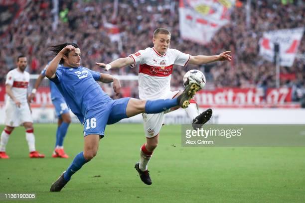 Nico Schulz of 1899 Hoffenheim challenges for the ball with Santiago Ascacibar of VfB Stuttgart during the Bundesliga match between VfB Stuttgart and...