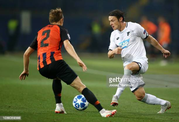 Nico Schulz of 1899 Hoffenheim is challenged by Bohdan Butko of Shakhtar Donetsk during the Group F match of the UEFA Champions League between FC...