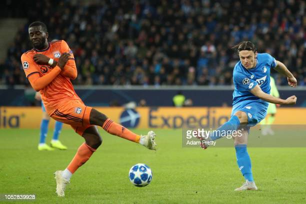 Nico Schulz of 1899 Hoffenheim shoots past Tanguy Ndombele of Olympique Lyonnais during the Group F match of the UEFA Champions League between TSG...