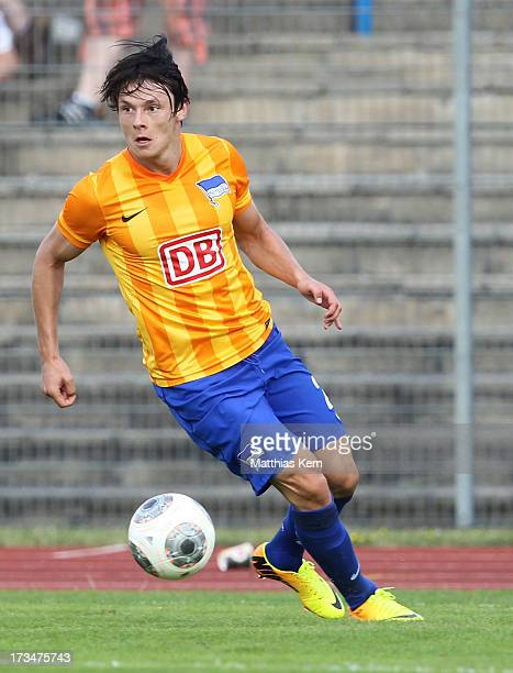 Nico Schulz of Berlin runs with the ball during the friendly match between Hertha BSC and RB Leipzig at Paul Greifzu Stadion on July 13 2013 in...
