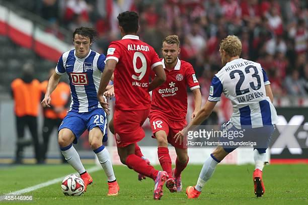 Nico Schulz of Berlin Sami Allagui of Mainz Daniel Brosinski of Mainz and Johannes van den Bergh of Berlin vie during the Bundesliga match between...