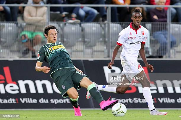 Nico Schulz of Borussia Moenchengladbach and Joaquim Adao of FC Sion battle for the ball during the UhrenCup match between FC Sion and Borussia...