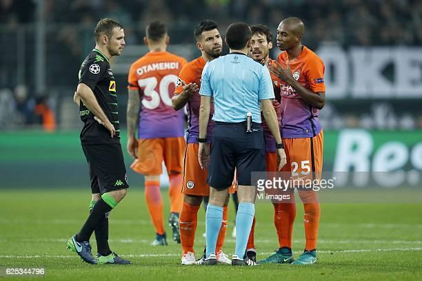 Nico Schulz of Borussia Monchengladbach Nicolas Otamendi of Manchester City Sergio Aguero of Manchester City referee Cuneyt Cakõr David Silva of...