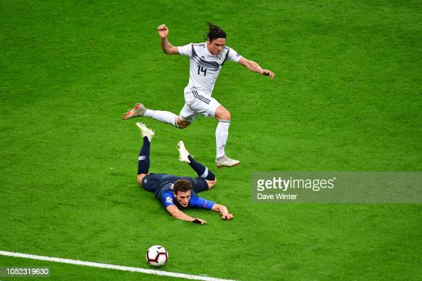 Nico Schulz of Germany and Benjamin Pavard of France during the Nations League match between France and Germany at Stade de France on October 16 2018...