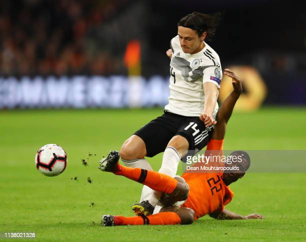Nico Schulz of Germany and Denzel Dumfries of the Netherlands battle for the ball during the 2020 UEFA European Championships Group C qualifying...