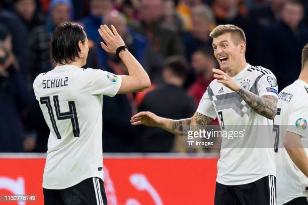 Nico Schulz of Germany and Toni Kroos of Germany celebrates after winning the 2020 UEFA European Championships group C qualifying match between...