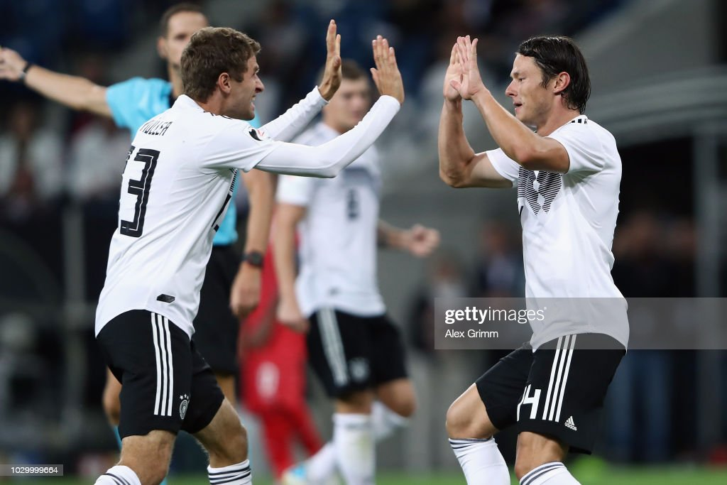 Nico Schulz of Germany celebrates his team's second goal with team mate Thomas Mueller during the International Friendly match between Germany and Peru at Wirsol Rhein-Neckar-Arena on September 9, 2018 in Sinsheim, Germany.