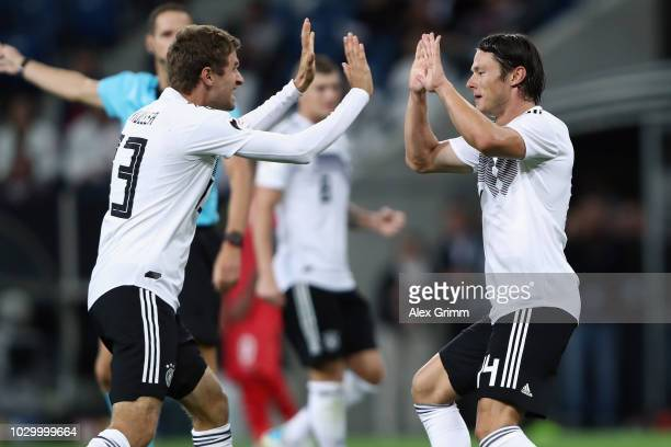 Nico Schulz of Germany celebrates his team's second goal with team mate Thomas Mueller during the International Friendly match between Germany and...