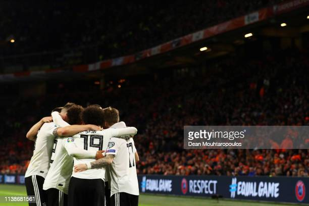 Nico Schulz of Germany celebrates scoring his teams third goal of the game with team mates during the 2020 UEFA European Championships group C...