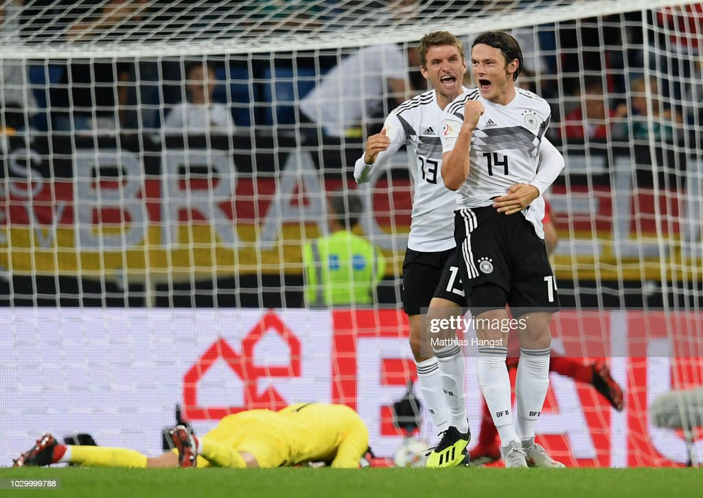 Nico Schulz of Germany celebrates with his team-mates after scoring his team's second goal during the International Friendly match between Germany and Peru on September 9, 2018 in Sinsheim, Germany.