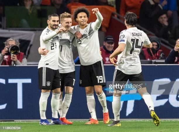 Nico Schulz of Germany celebrates with team mates after scoring his team's third goal during the 2020 UEFA European Championships group C qualifying...