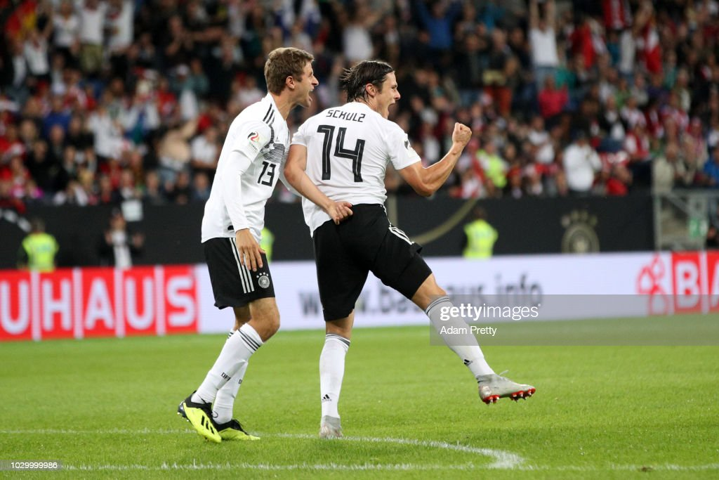 Nico Schulz of Germany celebrates with teammate Thomas Mueller after scoring his team's second goal during the International Friendly match between Germany and Peru at Rhein-Neckar-Arena on September 9, 2018 in Sinsheim, Germany.
