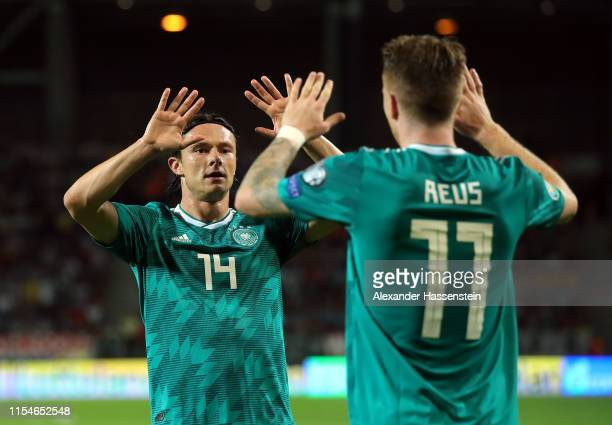 Nico Schulz of Germany congratulates teammate Marco Reus during the UEFA Euro 2020 qualifier match between Belarus and Germany at BorisovArena on...
