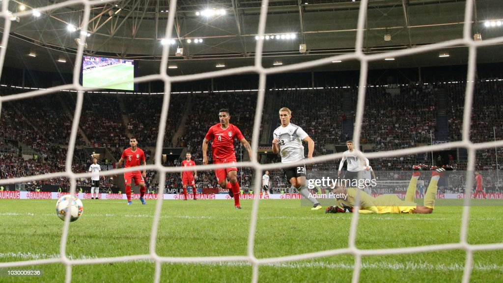 Nico Schulz of Germany (not pictured) scores his team's second goal past Pedro Gallese of Peru during the International Friendly match between Germany and Peru at Rhein-Neckar-Arena on September 9, 2018 in Sinsheim, Germany.
