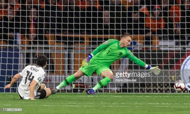 Nico Schulz of Germany scores his team's third goal during the 2020 UEFA European Championships group C qualifying match between Netherlands and...