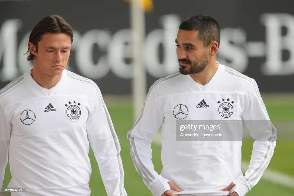 Nico Schulz of Germany talks to his team mate Ilkay Guendogan (R) during a Germany Training Session at Bayern Muenchen Campus on September 3, 2018 in Munich, Germany.