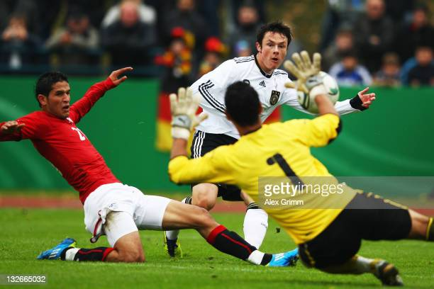 Nico Schulz of Germany tries to score against Mahmud Hamad Hassan Eid and goalkeeper Mahmoud Hamdi Ahmed Ali of Egypt during the U19 International...
