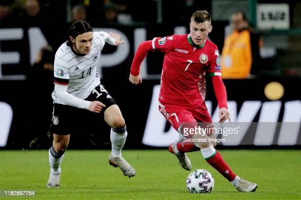 Nico Schulz of Germany Yuri Kovalev of Belarus during the EURO Qualifier match between Germany v Belarus on November 16 2019 in Gladbach Germany