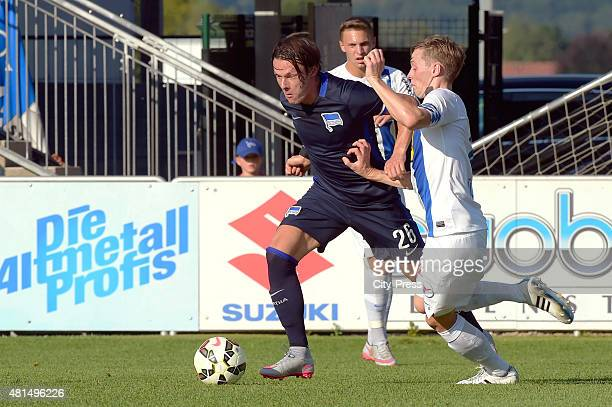 Nico Schulz of Hertha BSC and Robert Voelkl of SV Groedig during the game between SV Groedig and Hertha BSC on july 21 2015 in Schladming Austria