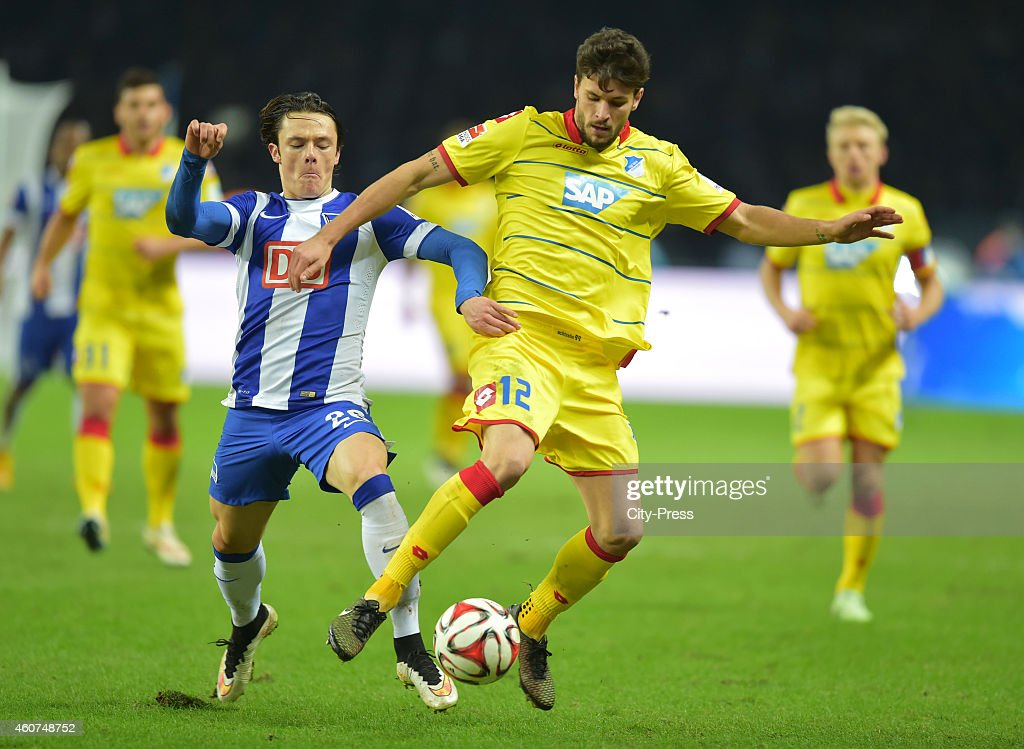 Nico Schulz of Hertha BSC and Tobias Strobl of the TSG 1899 Hoffenheim fight for the ball during the game between Hertha BSC and TSG Hoffenheim on December 21, 2014 in Berlin, Germany.