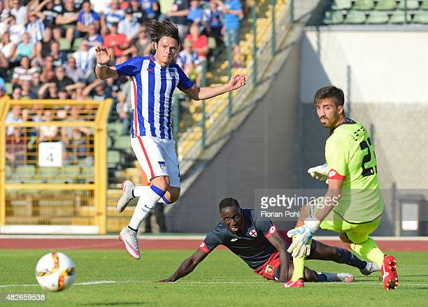 Nico Schulz of Hertha BSC passes the ball against Issa Cissokho and Eugenio Lamanna of CFC Genua during the game between Hertha BSC and CFC Genua on...