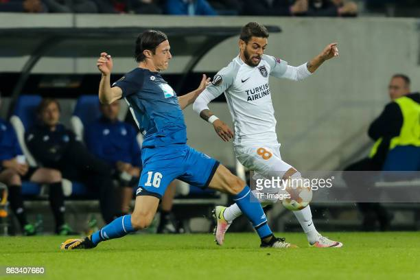 Nico Schulz of Hoffenheim and Junior Caicara of Istanbul Basaksehir battle for the ball during the UEFA Europa League Group C match between 1899...