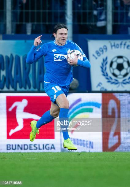 Nico Schulz of Hoffenheim celebrates his team's first goal during the Bundesliga match between TSG 1899 Hoffenheim and FC Bayern Muenchen at...