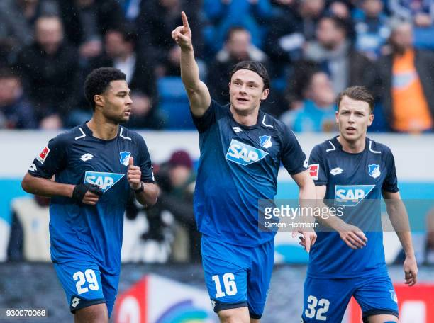 Nico Schulz of Hoffenheim celebrates his team's first goal with team mate Serge Gnabry during the Bundesliga match between TSG 1899 Hoffenheim and...