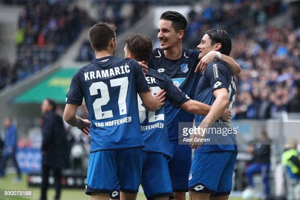 Nico Schulz of Hoffenheim celebrates with his team after he scored a goal to make it 10 during the Bundesliga match between TSG 1899 Hoffenheim and...